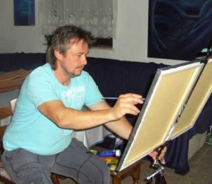 Norbert Nebenführ, beim Malen mit Pinsel